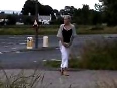 Cool girl pissing near the road
